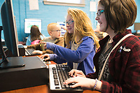 NWA Democrat-Gazette/CHARLIE KAIJO Harmony Kanthak, 11, (from right) and Anore DeRossi, 10, play Minecraft on a computer, Monday, March 26, 2018 at the Boys and Girls Club of Rogers in Rogers . <br />