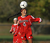 Tejan Singh #4 of Syosset makes a header during a Nassau County Class AA varsity girls soccer quarterfinal against host East Meadow High School on Tuesday, Oct. 25, 2016. Syosset won by a score of 2-1.
