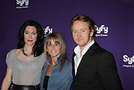 Jaime Murray & Tony Curran - Defiance with Bonnie Hammer (Chairman, NBCU Cable Entertainment and Cable Studios) at the Syfy Upfront 2012 on April 24, 2012 at the American Museum of Natural History, New York City  (Photo by Sue Coflin/Max Photos)