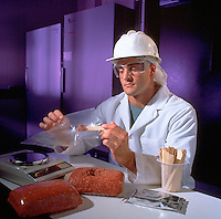 Man inspecting ground beef.