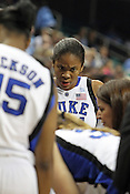 Duke forward Krystal Thomas listens to Coach Joanne P. McCallie during a timeout. This was the Championship game of the 2011 ACC Tournament in Greensboro on March 6, 2011. Duke beat UNC 81-66. (Photo by Al Drago)