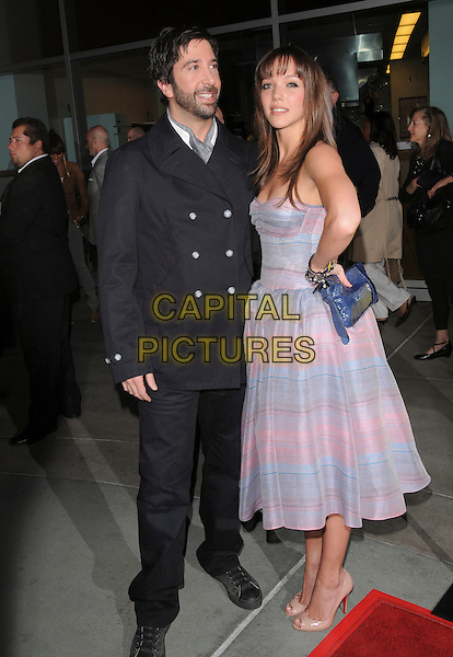 "DAVID SCHWIMMER & ZOE BUCKMAN .Attends The Picturehouse L.A. Premiere of ""Run Fatboy Run"" held at The Arclight Cinemas in Hollywood, California, USA,  March 24 2008.                                                                    .full length black coat purple lilac striped print dress strapless .CAP/DVS.©Debbie VanStory/Capital Pictures"