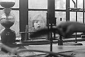 Looking in the window of the Science laboratory, Summerhill school, Leiston, Suffolk, UK. 1968.