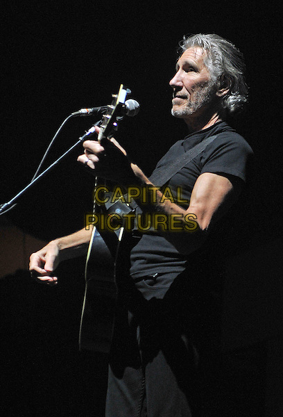 "English musician ROGER WATERS, a founder member of the progressive rock band Pink Floyd, performs ""The Wall"" at a stop on his tour held at Consol Energy Center, Pittsburgh, PA., USA..July 3rd, 2012.on stage in concert live gig performance performing music half length black t-shirt bass guitar side profile .CAP/ADM/JN.©Jason L Nelson/AdMedia/Capital Pictures."