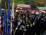 Hartford firefighter Kevin Bell, arrives on to the hose bed of Hartford Engine 16, his engine, during a funeral service, Monday, Oct. 13, 2014, at First Cathedral Church in Bloomfield. Bell was killed at a house fire in last week Hartford. (Jim Michaud / Journal Inquirer)