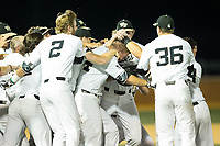 Gavin Sheets (24) of the Wake Forest Demon Deacons is mobbed by his teammates after his game winning hit in the bottom of the 9th inning against the West Virginia Mountaineers in Game Four of the Winston-Salem Regional in the 2017 College World Series at David F. Couch Ballpark on June 3, 2017 in Winston-Salem, North Carolina.  The Demon Deacons walked-off the Mountaineers 4-3.  (Brian Westerholt/Four Seam Images)