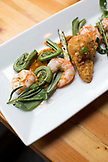 CANADA, Vancouver, British Columbia, shrimp and fiddlehead ferns are served at a local bistro, Edible Canada, located on Granville Island
