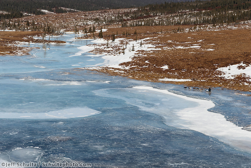 John Baker on river ice on the trail between Unalakleet and Shaktoolik on Sunday, March 9, during the Iditarod Sled Dog Race 2014.<br /> <br /> PHOTO (c) BY JEFF SCHULTZ/IditarodPhotos.com -- REPRODUCTION PROHIBITED WITHOUT PERMISSION
