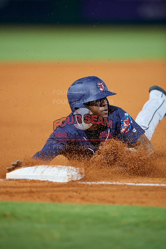 Jacksonville Jumbo Shrimp pinch hitter Anfernee Seymour (2) slides into third base during a game against the Pensacola Blue Wahoos on August 15, 2018 at Blue Wahoos Stadium in Pensacola, Florida.  Jacksonville defeated Pensacola 9-2.  (Mike Janes/Four Seam Images)