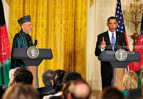 United States President Barack Obama, right, conducts a joint press conference with President Hamid Karzai of Afghanistan, left, in the East Room of the White House in Washington, DC on Wednesday, May 12, 2010..Credit: Ron Sachs / CNP