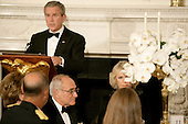 Washington, D.C. - November 2, 2005 -- United States President George W. Bush, left, offers a toast as Camilla, Duchess of Cornwall, of Great Britain, right, listens during a social dinner at the White House in Washington, D.C. on November 2, 2005. Britain's Prince Charles and the Duchess are on an eight-day visit to the United States and were honored at a rare black tie dinner in the State Dining Room of the White House..Credit: Jay L. Clendenin - Pool via CNP.(Restriction: No New York Metro or other Newspapers within a 75 mile radius of New York City)