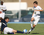 2 September 2007: Monmouth's Michael Millar (l) tackles the ball away from Wake Forest's Corben Bone (10). The Wake Forest University Demon Deacons defeated the Monmouth University Hawks 2-0 at Fetzer Field in Chapel Hill, North Carolina in an NCAA Division I Men's Soccer game.