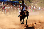 A Palestinian jockey competes during a horse race in the West Bank village of Abu Falah, near the town of Ramallah ,on 02 September 2011. Some 60 horses in different heats participated in races through the day, attracting jockeys from across the West bank and from some Arab-Israeli towns. Photo by Issam Rimawi