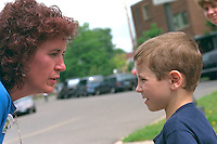 Mother talking to son ages 32 and 7 at Grand Old Day Festival Parade.  St Paul  Minnesota USA