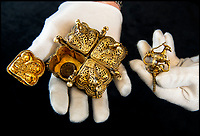 BNPS.co.uk (01202) 558833<br /> Pic: PhilYeomans/BNPS<br /> <br /> The peacock lock revealed 220 year old betel nuts. Tipu Sultan's ornate solid gold betel nut casket.<br /> <br /> Stunning artefacts from Indian hero Tipu Sultan's fateful last stand have been rediscovered by the family of an East India Company Major who took part in the famous battle that ended his reign.<br /> <br /> And now Major Thomas Hart's lucky descendents are likely to become overnight millionaires after retrieving the historic items from their dusty attic.<br /> <br /> The fascinating treasures were taken from Tipu's captured fortress of Seringapatam in the wake of his defeat by British forces led by a young Duke of Wellington in 1799.<br /> <br /> The cache of ornate gold arms and personal effects even include's the battle damaged musket the Sultan used in his fatal last stand against the expanding British Empire in India.<br /> <br /> Tipu was last seen on the battlements of the fortress firing his hunting musket at the advancing British and after the fierce encounter his body was found bearing many wounds, including a musket ball shot above his right eye.<br /> <br /> The rediscovered musket, complete with battle damaged bayonet, has the distinctive tiger stripe pattern unique to the self styled Tiger of Mysore own weapons - and tellingly there is also shot damage to the lock and stock that may have been caused by the musket ball that finished him off.<br /> <br /> Also included in the sale are four ornate gold-encrusted sword's bearing the mark of Haider Ali Khan, Tipu's father and the previous ruler of independent Mysore, along with a solid gold &lsquo;betel casket&rsquo; complete with three 220 year old nuts still inside.<br /> <br /> The war booty was brought back to Britain by Major Thomas Hart of the British East India Company following the fourth and final Anglo-Mysore war.<br /> <br /> They have been passed down through the family ever since and now belong to a couple who have kept them wrapped in newspaper in the dusty attic of their semi-detached home for years.