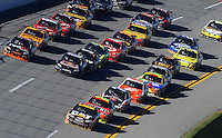 Nov. 1, 2009; Talladega, AL, USA; NASCAR Sprint Cup Series drivers Denny Hamlin (left), Brian Vickers (center) and Jeff Burton lead three lines of cars during the Amp Energy 500 at the Talladega Superspeedway. Mandatory Credit: Mark J. Rebilas-