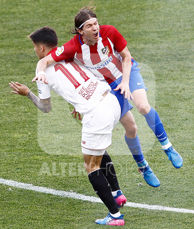 Atletico de Madrid's Filipe Luis (r) and Sevilla FC's Joaquin Correa during La Liga match. March 19,2017. (ALTERPHOTOS/Acero)