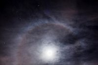 """The November full moon, the Beaver Full Moon,  with a halo.  According to Earthsky.org, """"Halos around the moon – or sun – are a sign of thin cirrus clouds drifting high above our heads. They are a sign of nearby storms."""""""
