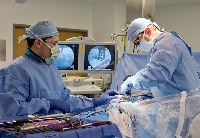 Dr. James L. Lynch, MD, operates during a spine surgery at St. Mary's Regional Medical Center on February 20, 2014.