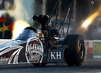 Apr 25, 2014; Baytown, TX, USA; NHRA top fuel dragster driver Shawn Langdon experiences tire shake during qualifying for the Spring Nationals at Royal Purple Raceway. Mandatory Credit: Mark J. Rebilas-USA TODAY Sports