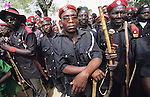 The Vigilantes, a volunteer militia group charged with controlling delinquancy, including drugs and crime..The implementation of Islamic Sharia Law across the twelve northern states of Nigeria, centres upon Kano, the largest Muslim Husa city, under the feudal, political and economic rule of the Emir of Kano. Islamic Sharia Law is enforced by official state apparatus including military and police, Islamic schools and education, plus various volunteer Militia groups supported financially and politically by the Emir and other business and political bodies. Fanatical Islamic Sharia religious traditions  are enforced by the Hispah Sharia police. Deliquancy is controlled by the Vigilantes volunteer Militia. Activities such as Animist Pagan Voodoo ceremonies, playing music, drinking and gambling, normally outlawed under Sharia law exist as many parts of the rural and urban areas are controlled by local Mafia, ghetto gangs and rural hunters. The fight for control is never ending between the Emir, government forces, the Mafia and independent militias and gangs. This is fueled by rising petrol costs, and that 70% of the population live below the poverty line. Kano, Kano State, Northern Nigeria, Africa