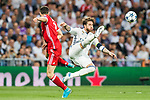 Robert Lewandowski (L) of FC Bayern Munich battles for the ball with Sergio Ramos (R) of Real Madrid during their 2016-17 UEFA Champions League Quarter-finals second leg match between Real Madrid and FC Bayern Munich at the Estadio Santiago Bernabeu on 18 April 2017 in Madrid, Spain. Photo by Diego Gonzalez Souto / Power Sport Images