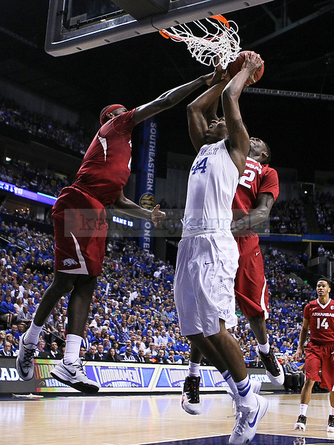 Kentucky center Dakari Johnson gets fouled while shooting the ball during the first half of the Championship game of the SEC tournament against Arkansas in Nashville , Tenn., on Sunday, March 15, 2015. Photo by Jonathan Krueger | Staff