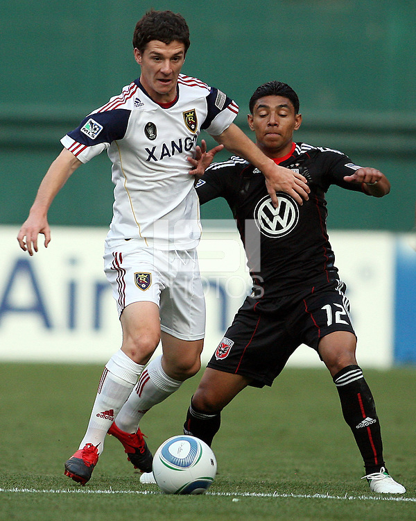 Cristian Castillo #12 of D.C. United challenges Will Johnson #8  of Real Salt Lake during an Open Cup match at RFK Stadium, on June 2 2010 in Washington DC. DC United won 2-1.