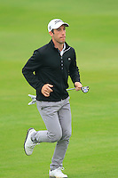 Romain Wattel (FRA) runs to the 1st green during Saturay's Round 3 of the 2014 BMW Masters held at Lake Malaren, Shanghai, China. 1st November 2014.<br /> Picture: Eoin Clarke www.golffile.ie