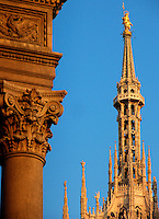 The Duomo spires with column detail of Galleria Vittorio Emanuele II in foreground, Milan, Ital