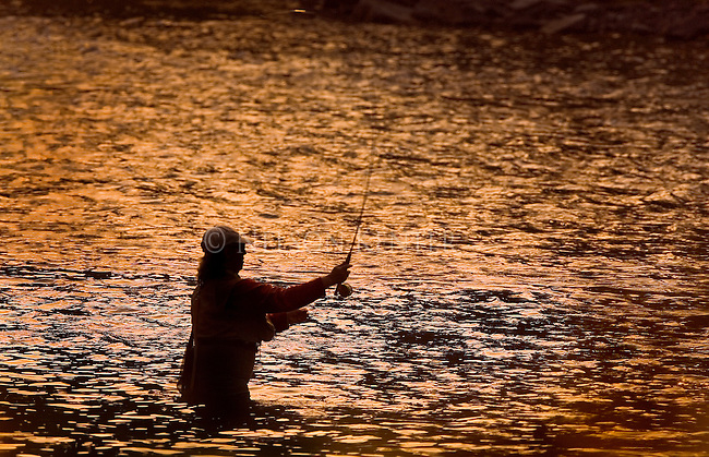 A fly fisherwoman in the Blackfoot River in Montana