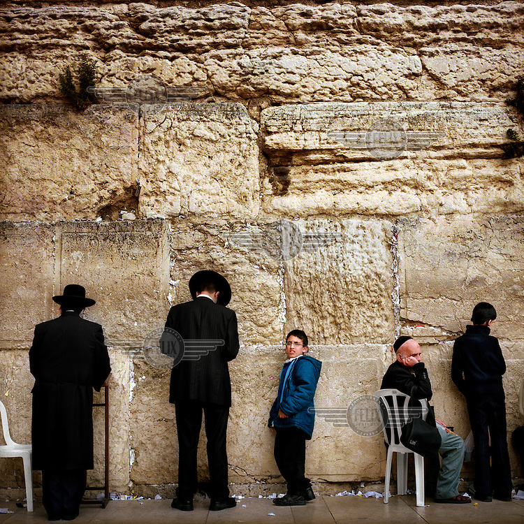 Orthodox Jews pray at the Western Wall (also known as the Wailing Wall or The Kotel) in the Old City of Jerusalem.