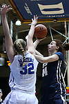 29 January 2015: Pitt's Fred Potvin (CAN) (14) and Duke's Erin Mathias (32). The Duke University Blue Devils hosted the University of Pittsburgh Panthers at Cameron Indoor Stadium in Durham, North Carolina in a 2014-15 NCAA Division I Women's Basketball game. Duke won the game 62-45.