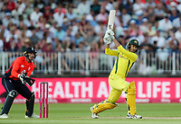 Australia's Ashton Agar hits out as England's Jos Buttler looks on<br /> <br /> Photographer Andrew Kearns/CameraSport<br /> <br /> Only IT20 - Vitality IT20 Series - England v Australia - Wednesday 27th June 2018 - Edgbaston - Birmingham<br /> <br /> World Copyright &copy; 2018 CameraSport. All rights reserved. 43 Linden Ave. Countesthorpe. Leicester. England. LE8 5PG - Tel: +44 (0) 116 277 4147 - admin@camerasport.com - www.camerasport.com