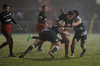 Brad Barritt of Saracens is sandwiched between Fraser Balmain and Harry Thacker of Leicester Tigers during the Premiership Rugby match between Saracens and Leicester Tigers - 02/01/2016 - Allianz Park, London<br /> Mandatory Credit: Rob Munro/Stewart Communications