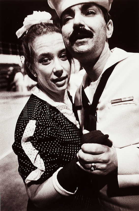 Vintage photograph of a sailor and his girlfriend dancing.