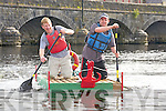 Powering their way to the finish line of the Astellas raft race in Killorglin on Friday evening were Con Lucey and Tim O'Sullivan, The China VI's mk1.
