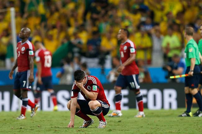 James Rodriguez reacciona con desolucion tras el final del partido de cuartos de final entre Colombia y Brasil en el Estadio Aderaldo Pl&aacute;cido Castelo el 3 de julio de 2014.<br /> <br /> Foto: Roberto Candia/Archivolatino<br /> <br /> COPYRIGHT: Archivolatino<br /> Solo para uso editorial. No esta permitida su venta o uso comercial.