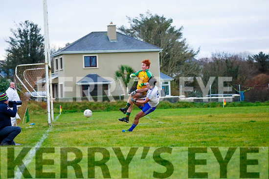 A dangerous ball launched into the box sees Skellig Rangers keeper Pádraig O'Sullivan and Mary's man Jack Daly compete in and aerial battle.
