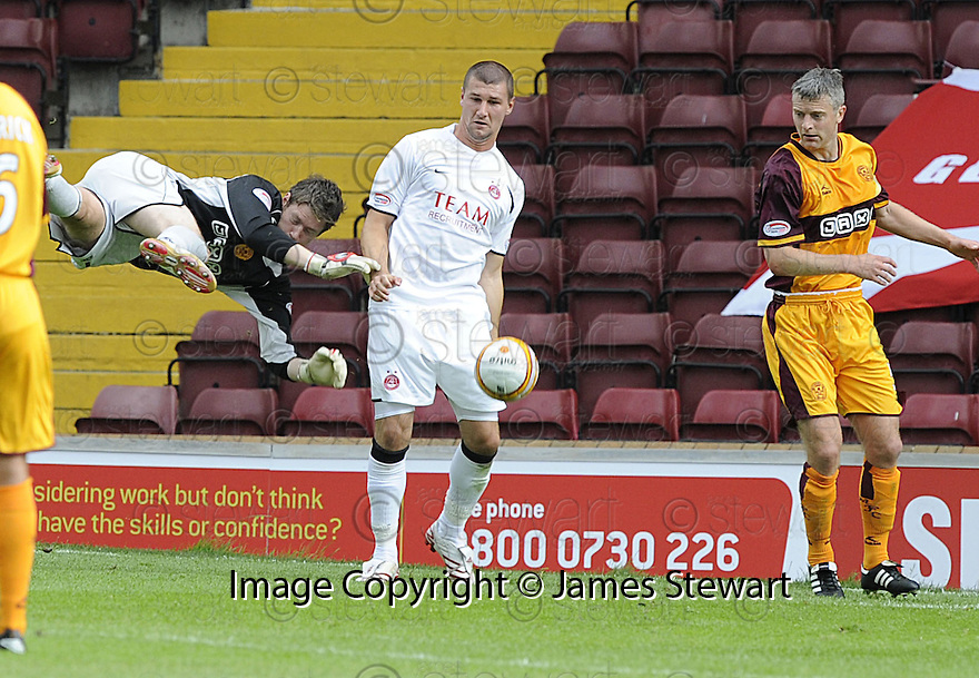 16/08/2008  Copyright Pic: James Stewart.File Name : sct_jspa26_motherwell_v_aberdeen.TOMMY WRIGHT  BUNDLES GRAEME SMITH OFF THE BALL....James Stewart Photo Agency 19 Carronlea Drive, Falkirk. FK2 8DN      Vat Reg No. 607 6932 25.Studio      : +44 (0)1324 611191 .Mobile      : +44 (0)7721 416997.E-mail  :  jim@jspa.co.uk.If you require further information then contact Jim Stewart on any of the numbers above........
