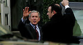 United States President George W. Bush waves as he leaves St. John's Episcopal  Church in Washington, DC on January 16, 2005. On the right a Secret Service agent holds the car door for President Bush. <br /> Credit: Dennis Brack / Pool via CNP