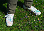 At Celebrate Earth Day at Nassau County Museum of Art, JOHN CLOUD KAISER, an artist from NYC art collective Free Style Arts Association, is wearing clothes, including white shoes, colorfully decorated by visitors.