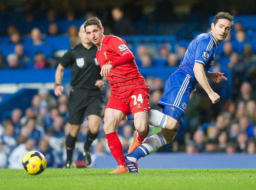 Liverpool's Joe Allen battles with Chelsea's Frank Lampard<br /> <br /> Photo by Ashley Western/CameraSport<br /> <br /> Football - Barclays Premiership - Chelsea v Liverpool - Sunday 29th December 2013 - Stamford Bridge - London<br /> <br /> &copy; CameraSport - 43 Linden Ave. Countesthorpe. Leicester. England. LE8 5PG - Tel: +44 (0) 116 277 4147 - admin@camerasport.com - www.camerasport.com