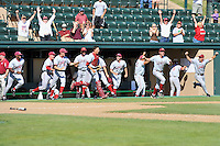 02 June 2008:  Stanford Cardinal players and coaches, Brendan Domaracki (14), Wande Olabisi (12), Alex Pracher (44), Jeff Whitlow (1), Jason Castro (15), Jeremy Bleich (21), Erik Davis (19), and coaches Dean Stotz (32), Mark Marquess (9), and Jeff Austin (8) celebrate after the final out of Stanford's 9-7 win over the Pepperdine Waves in the NCAA Stanford Regional final game at Klein Field at Sunken Diamond in Stanford, CA.