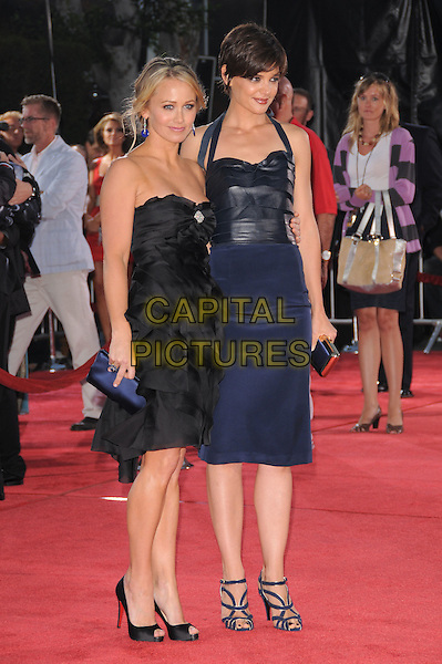 """CHRISTINE TAYLOR & KATIE HOLMES.The Dreamwork's L.A. Premiere of """"Tropic Thunder"""" held at The Mann's Village Theatre in Westwood, California, USA..August 11th, 2008.full length blue halterneck dress black strapless clutch bag ruffled ruffles layers layered .CAP/DVS.©Debbie VanStory/Capital Pictures."""