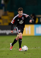 Chris Pontius (13) of D.C. United brings the ball through midfield during the game at RFK Stadium in Washington DC. D.C. United tied New York Red Bulls, 1-1.