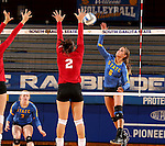BROOKINGS, SD - SEPTEMBER 25:  Brittany Jessen #2 from the University of South Dakota tries to block a kill attempt on Nazya Thies #6 from South Dakota State University during their match Sunday afternoon at Frost Arena. (Photo by Dave Eggen/Inertia)