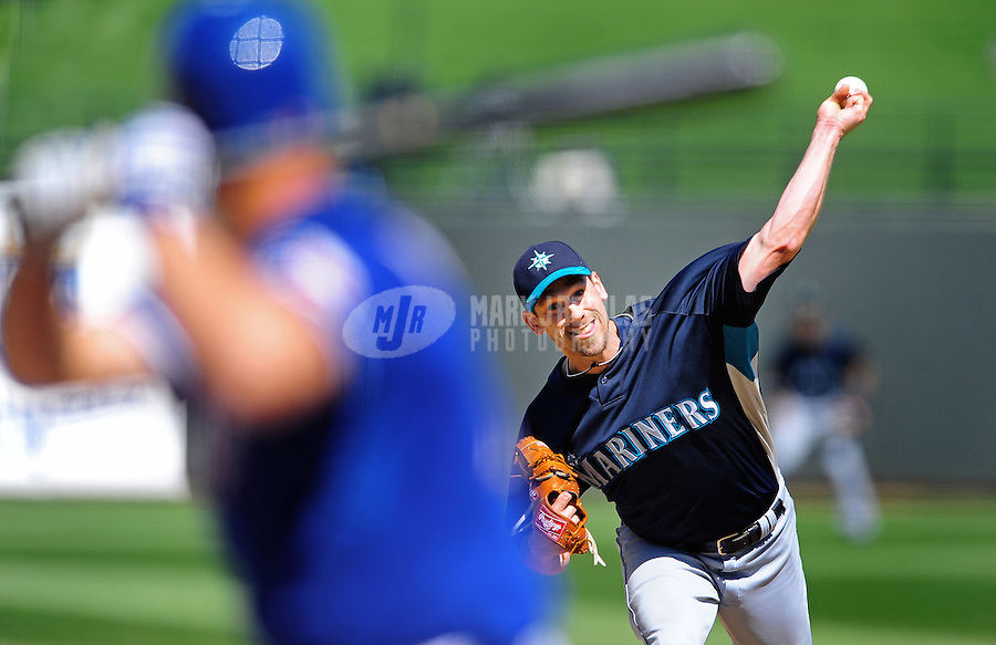 Mar. 10, 2010; Tempe, AZ, USA; Seattle Mariners pitcher Cliff Lee throws against the Texas Rangers during a spring training game at Surprise Stadium. Mandatory Credit: Mark J. Rebilas-