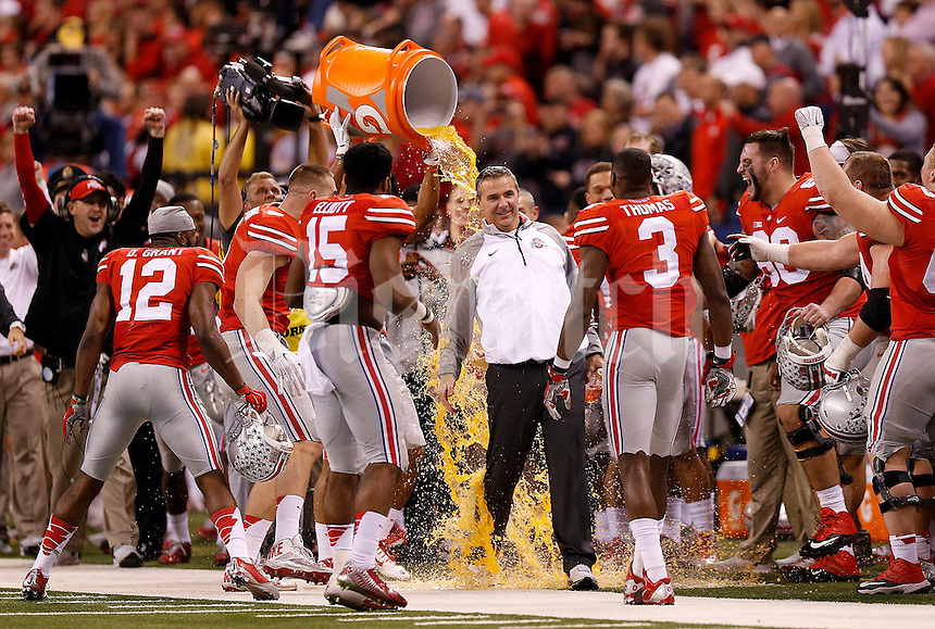 Ohio State Buckeyes head coach Urban Meyer gets Gatorade dumped on him following the Big Ten Championship game at Lucas Oil Stadium in Indianapolis on Saturday, December 6, 2014. (Columbus Dispatch photo by Jonathan Quilter)