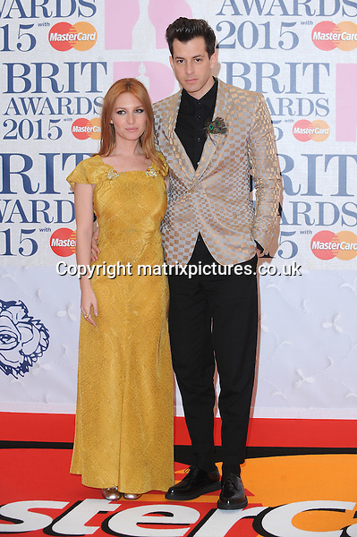 NON EXCLUSIVE PICTURE: PAUL TREADWAY / MATRIXPICTURES.CO.UK<br /> PLEASE CREDIT ALL USES<br /> <br /> WORLD RIGHTS<br /> <br /> English musician Mark Ronson and his wife, Josephine de la Baume attending the BRIT Awards 2015 at the O2 Arena, in London.<br /> <br /> FEBRUARY 25th 2015<br /> <br /> REF: PTY 15627